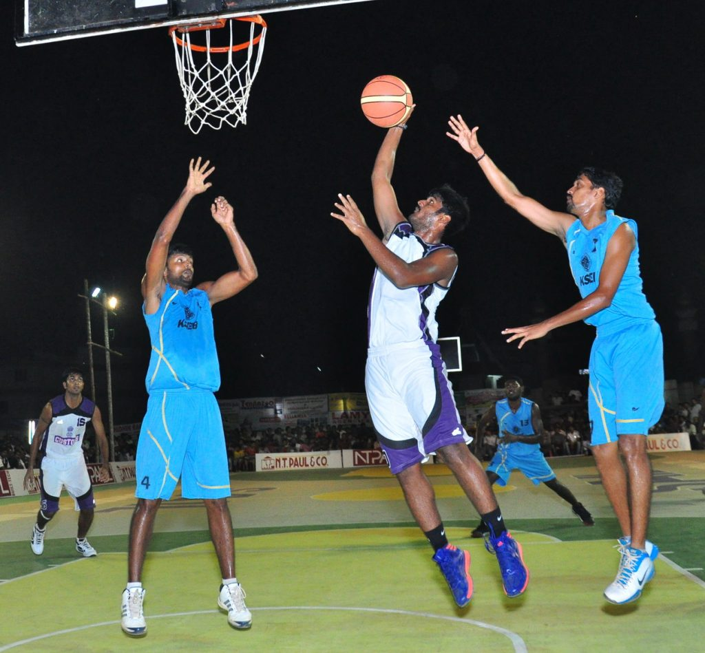 A Customs Chennai player scores against KSEB
