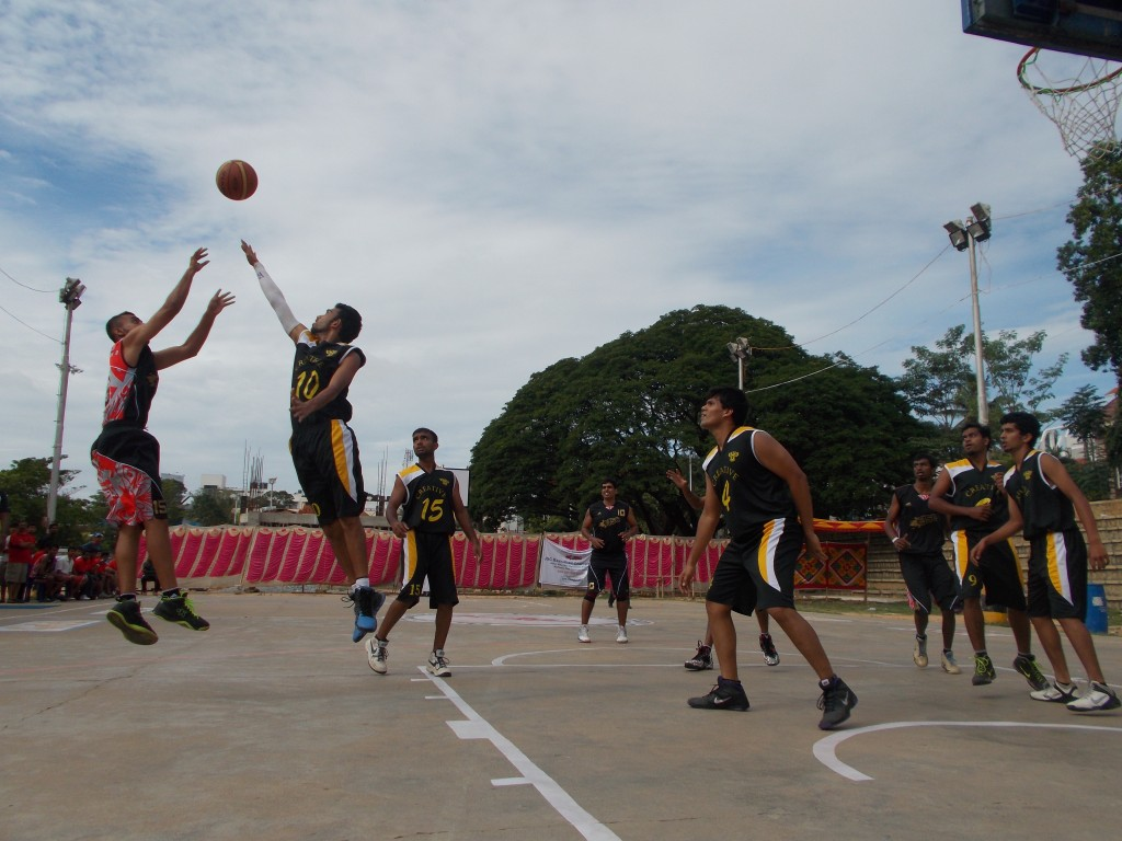 Akshay of JSC attempts a jumpshot against Creative BC. JSC would go on to win.