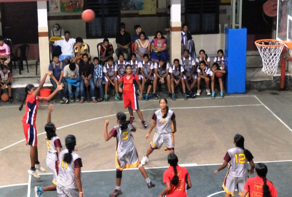 Nimmy for Little Flower attempts a jumpshot against Providence, Kozhikode.