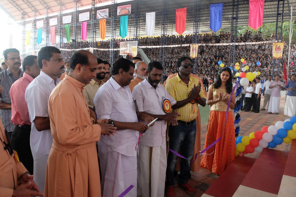 Hon Minister Thiruvanchoor Radhakrishna inaugurating the newly built indoor stadium In Kottayam. Also seen is IM Vijayan, Footballer.