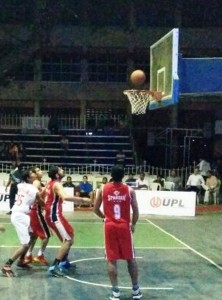 Action from the men's semi-final league match between Services (red) and Bhavnagar Youngsters.