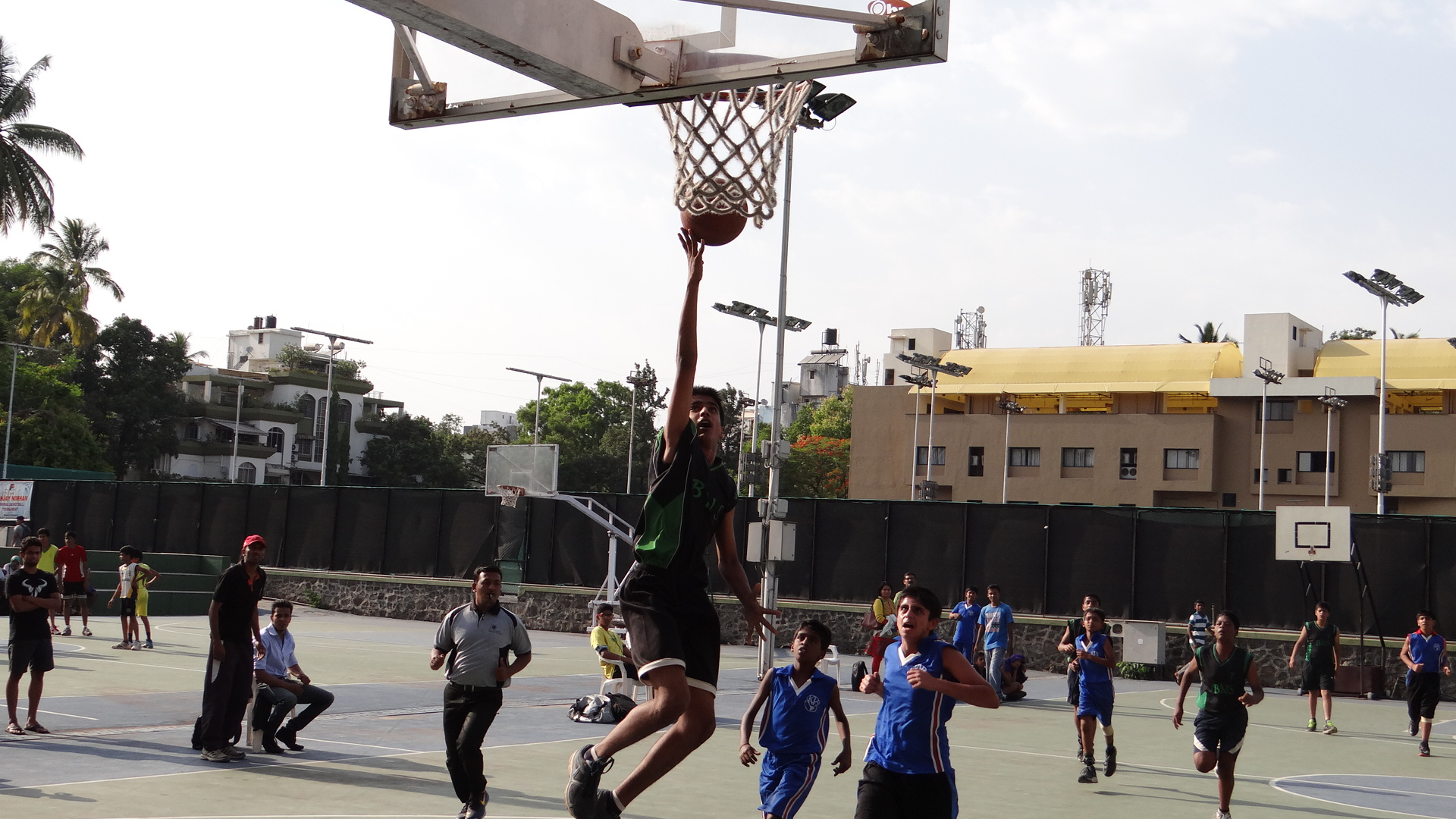 Boys match between Bharati Nivas Society (Black) and Kamal Nayan Bajaj (Blue).
