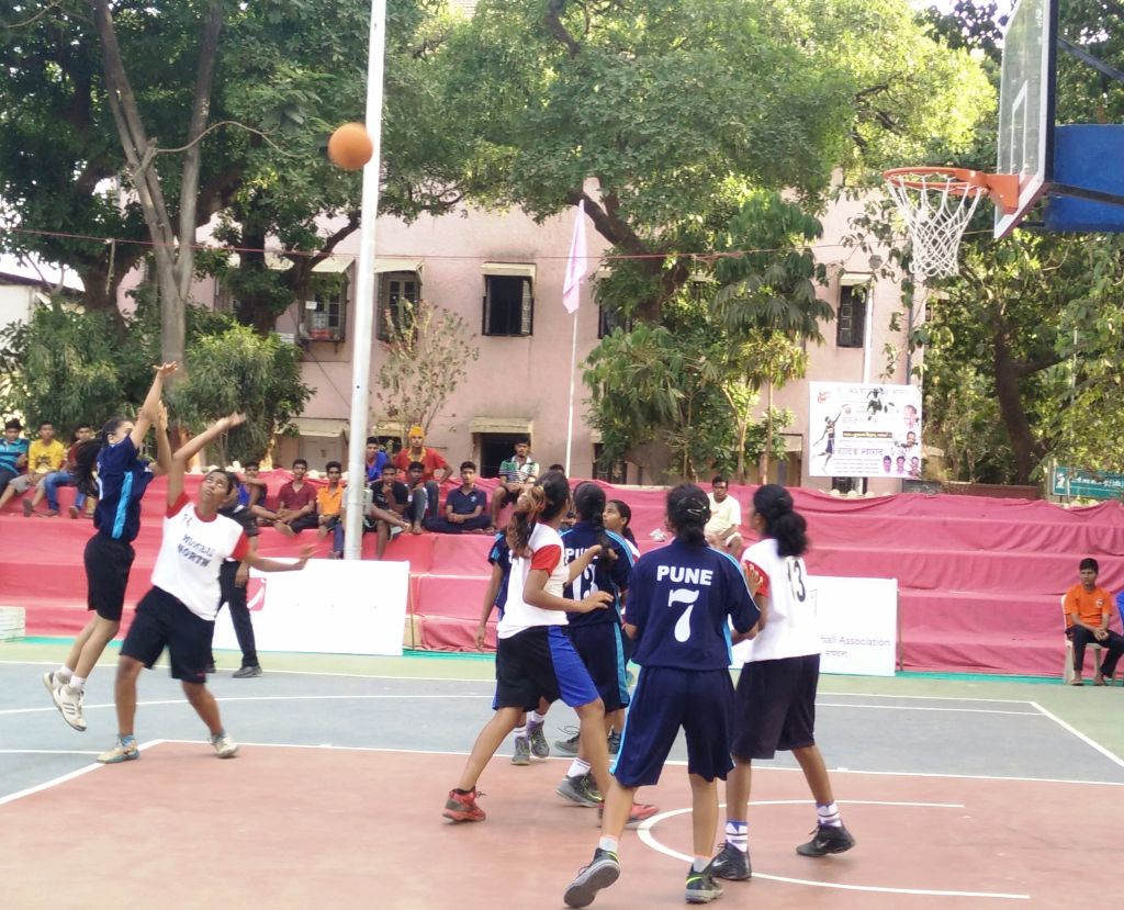 Pune's Shruti Sherigar (left) attempts a basket against Mumbai North during a girl's semi-final match of the 32nd Maharashtra State Inter-District Youth (boys & girls) Basketball Championship. Shruti scored a high 24 points in leading Pune to a 55-15 win.