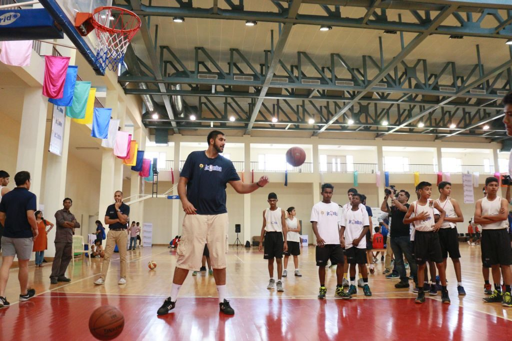 Sim Bhullar giving some tips to the kids at the Jr NBA Elite National Camp in Greater Noida.