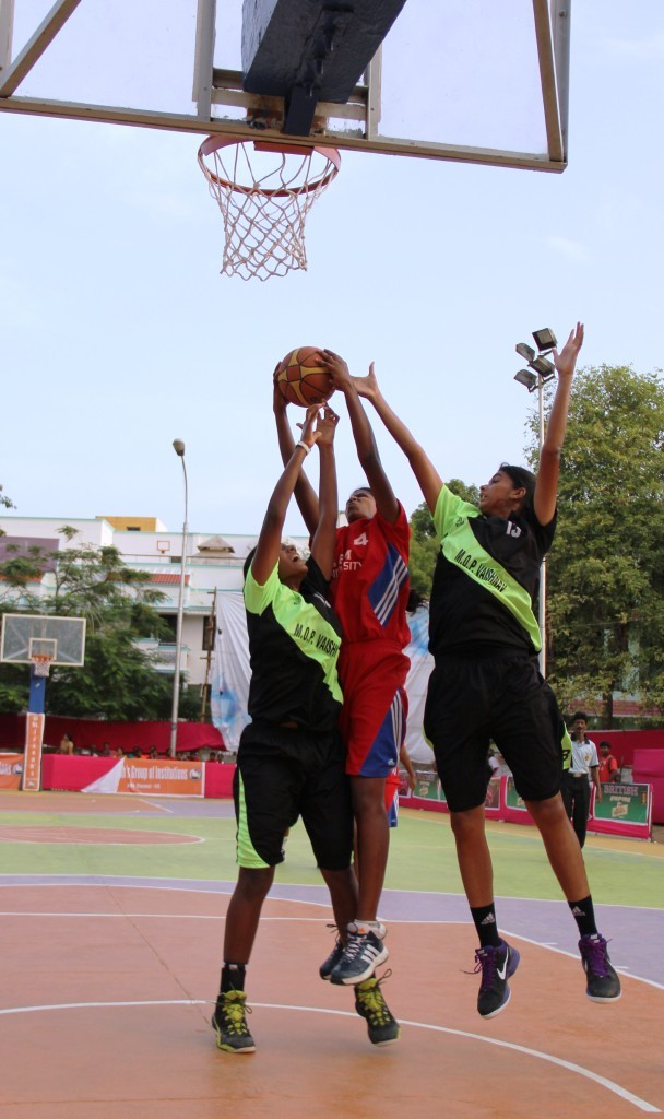 MOP Vaishnav (in black) vs SRM University during the Raghavendra Trophy
